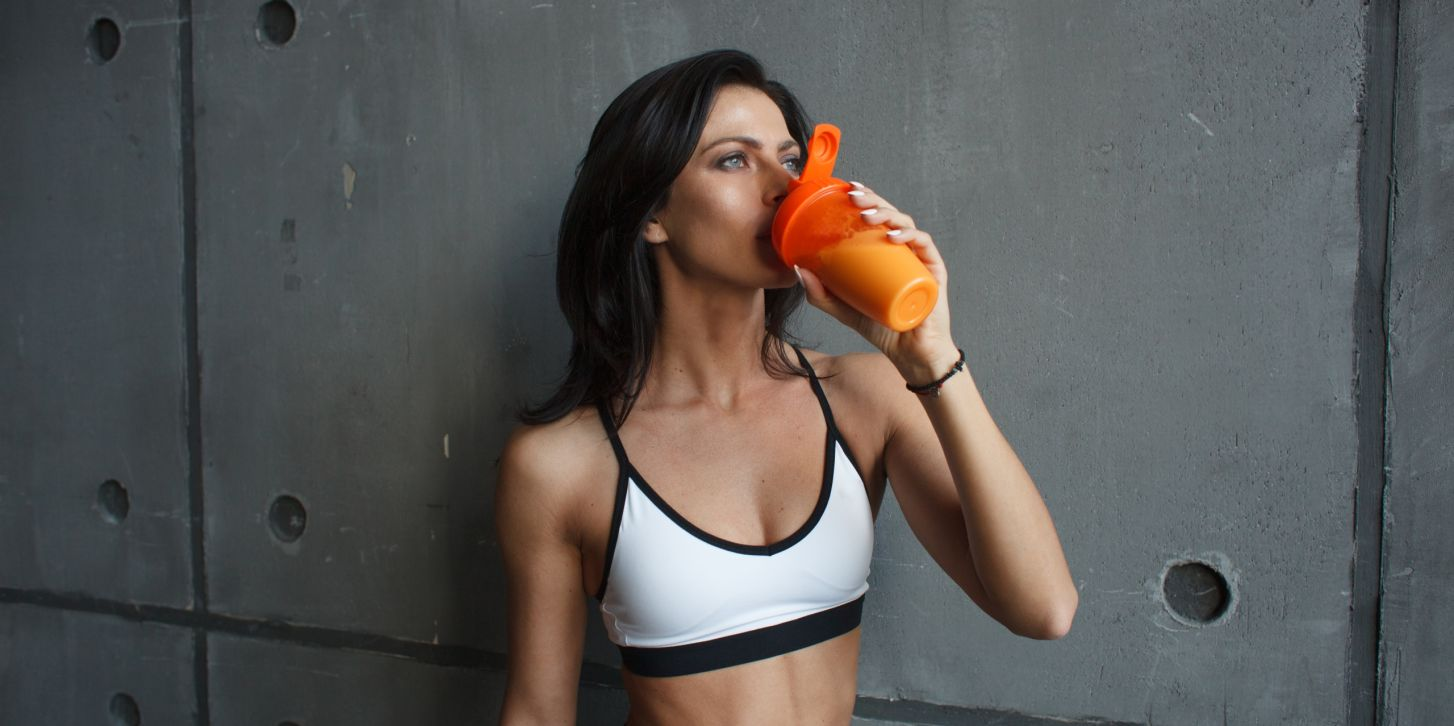 fitness woman drink cocktail