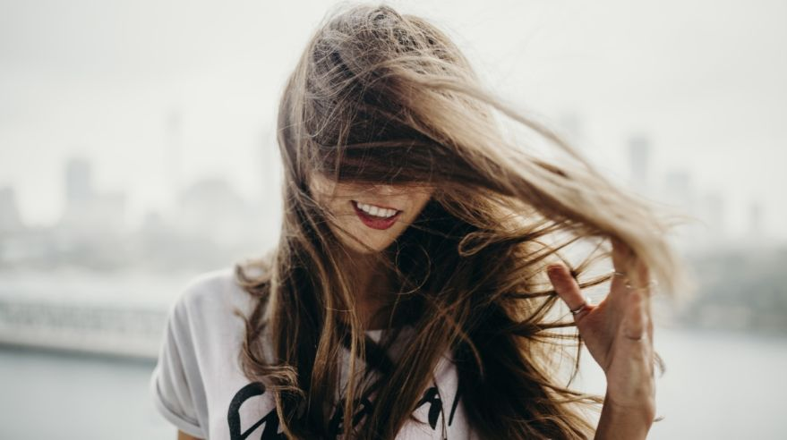 Woman moving and touching her haire.