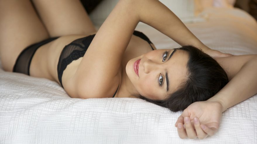 Attractive young woman on the bed