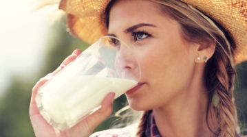 Young woman with fresh organic milk